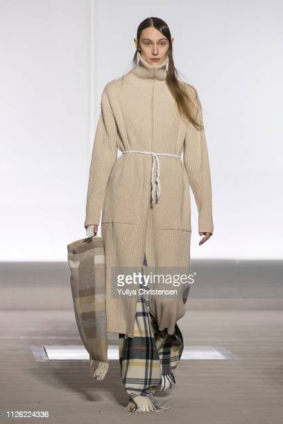 Model walks the runway at the Holzweiler show during the Copenhagen Fashion Week Autumn/Winter 2019 on January 30, 2019 in Copenhagen, Denmark.