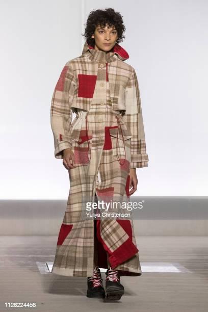 Model walks the runway at the Holzweiler show during the Copenhagen Fashion Week Autumn/Winter 2019 on January 30, 2019 in Copenhagen, Denmark.