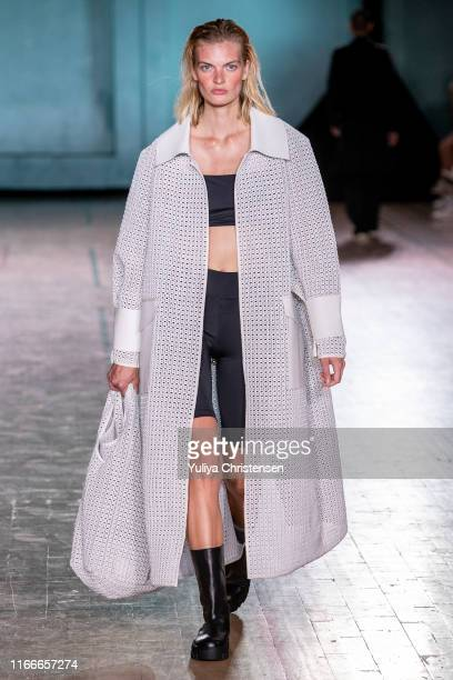 Model walks the runway at the Holzweiler show during the Copenhagen Fashion Week Spring/Summer 2020 on August 07, 2019 in Copenhagen, Denmark.