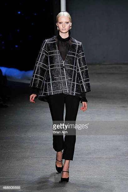A model walks the runway at the Honor fashion show during MercedesBenz Fashion Week Fall 2014 at Eyebeam on February 10 2014 in New York City