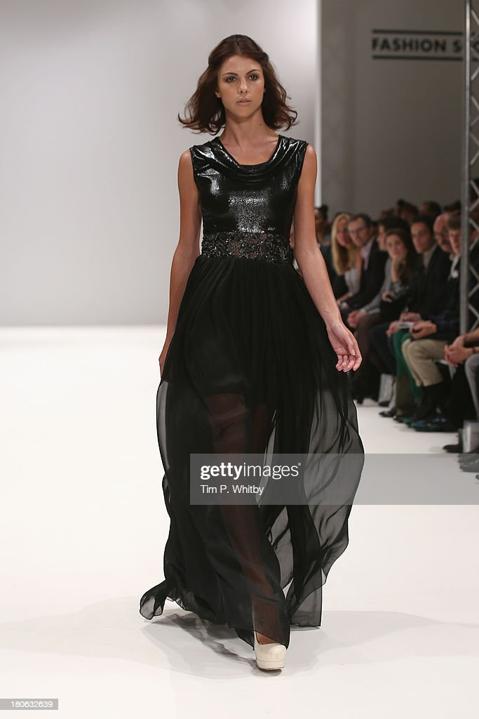 A model walks the runway at the House Of Evolution show at the Fashion Scout venue during London Fashion Week SS14 at Freemasons Hall on September 15, 2013 in London, England.