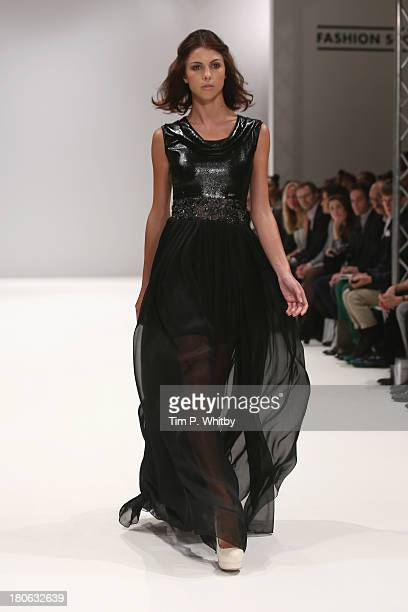 A model walks the runway at the House Of Evolution show at the Fashion Scout venue during London Fashion Week SS14 at Freemasons Hall on September 15...