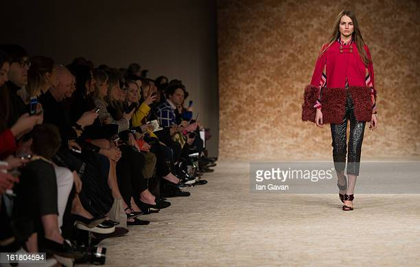 Model walks the runway at the House of Holland show during London Fashion Week Fall/Winter 2013/14 at Brewer Street Car Park on February 16, 2013 in...