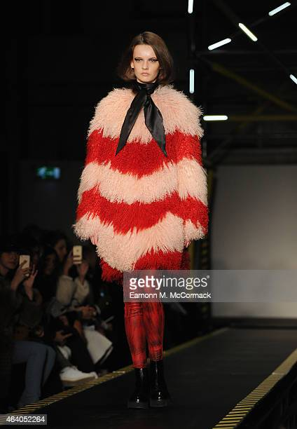 Model walks the runway at the House of Holland show during London Fashion Week Fall/Winter 2015/16 at University of Westminster on February 21, 2015...