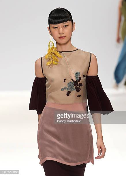 A model walks the runway at the House of Mea show during London Fashion Week Spring/Summer collections 2016/2017 on September 18 2016 in London...