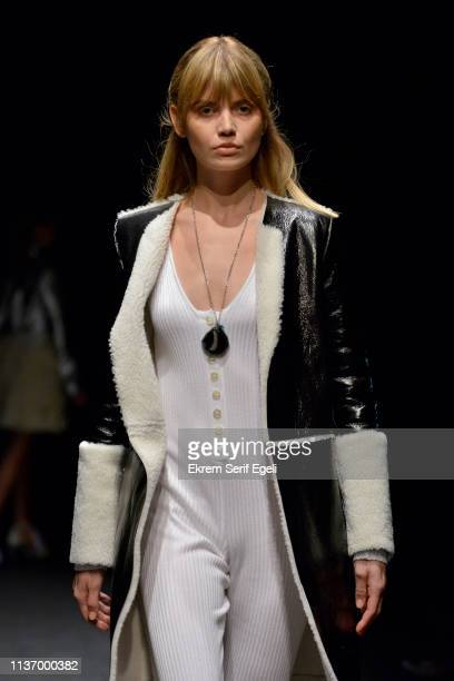 A model walks the runway at the House Of Ogan show during MercedesBenz Istanbul Fashion Week at the Zorlu Performance Hall on March 20 2019 in...