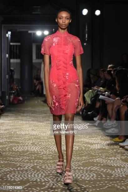Model walks the runway at the Huishan Zhang show during London Fashion Week September 2019 at Rosewood London on September 16, 2019 in London,...