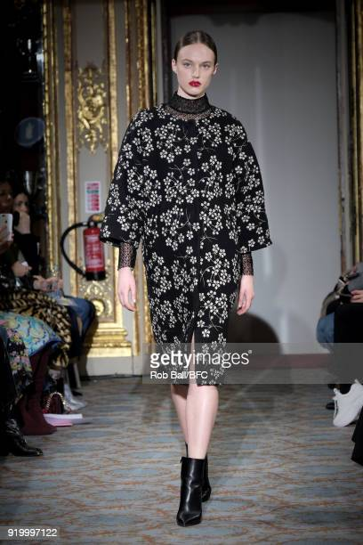 A model walks the runway at the Huishan Zhang show during London Fashion Week February 2018 at The Savile Club on February 18 2018 in London England