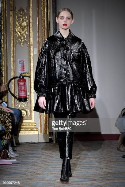 Model walks the runway at the Huishan Zhang show during London Fashion Week February 2018 at The Savile Club on February 18, 2018 in London, England.