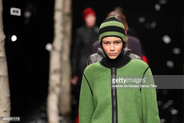 A model walks the runway at the Hunter Original show at London Fashion Week AW14 at University of Westminster on February 15 2014 in London England