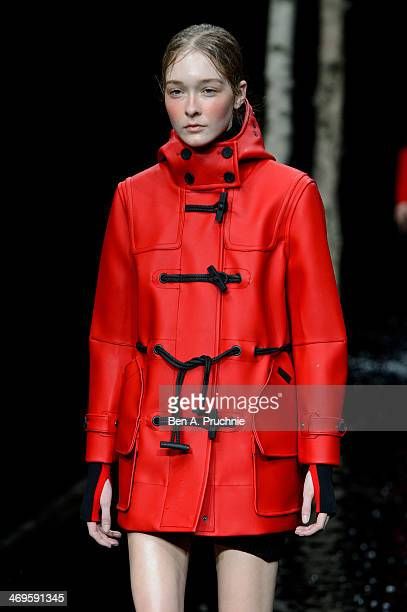 Model walks the runway at the Hunter Original show at London Fashion Week AW14 at University of Westminster on February 15, 2014 in London, England.