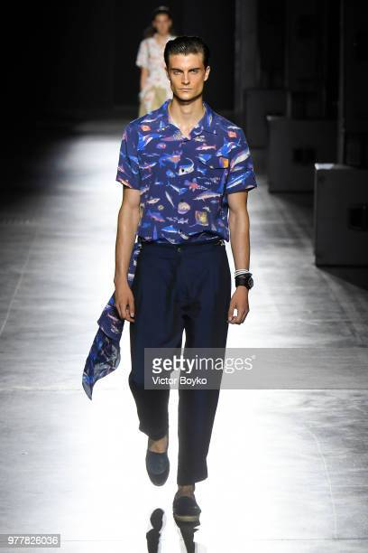 A model walks the runway at the Hunting World show during Milan Men's Fashion Week Spring/Summer 2019 on June 18 2018 in Milan Italy