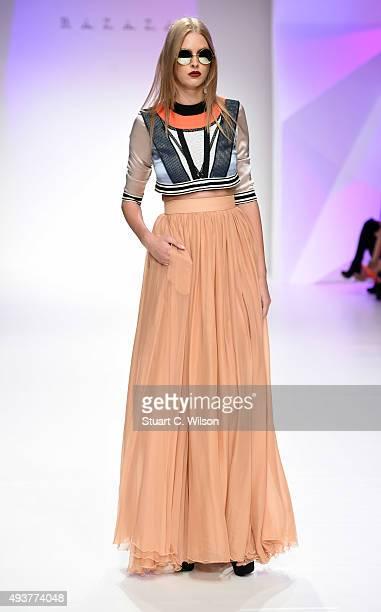 A model walks the runway at the Hussein Bazaza show during Dubai Fashion Forward Spring/Summer 2016 at Madinat Jumeirah on October 22 2015 in Dubai...