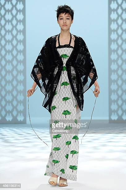 Model walks the runway at the Hussein Chalayan Spring Summer 2015 fashion show during Paris Fashion Week on September 26, 2014 in Paris, France.