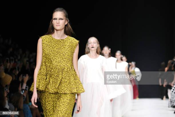 A model walks the runway at the I V K A fashion show during day five of Mercedes Benz Fashion Week Russia S/S 2018 at Manege on October 25 2017 in...