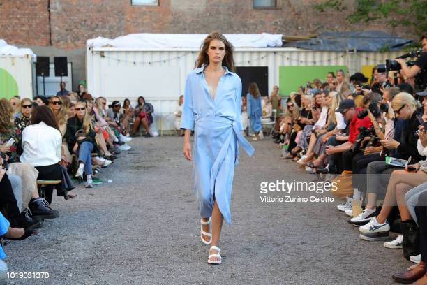 A model walks the runway at the Iben show during Oslo Runway SS19 at Prindsen Hage on August 14 2018 in Oslo Norway