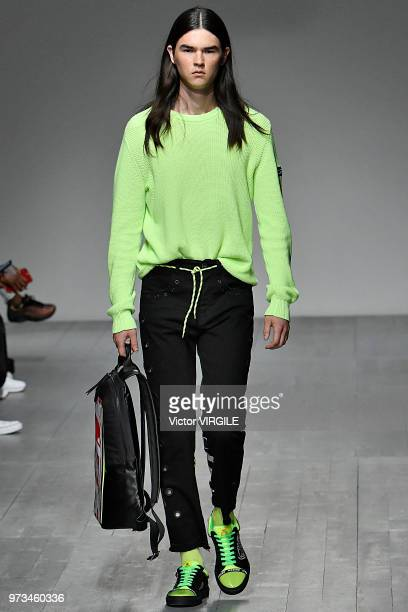 A model walks the runway at the ICEBERG Spring/Summer 2019 fashion show during London Fashion Week Men's June 2018 on June 8 2018 in London England