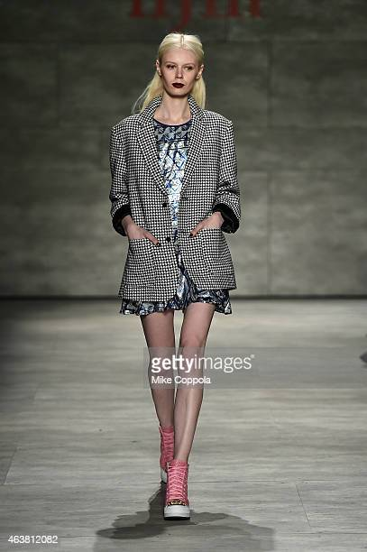 Model walks the runway at the IIJIN fashion show during Mercedes-Benz Fashion Week Fall at The Pavilion at Lincoln Center on February 18, 2015 in New...