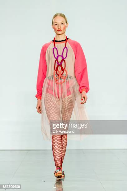 A model walks the runway at the iiS Woodling show during Fashion Week Oslo on August 23 2017 in Oslo Norway