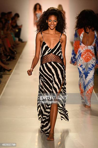 A model walks the runway at the Indah fashion show during MercedesBenz Fashion Week Swim 2015 at The Raleigh on July 21 2014 in Miami Beach Florida