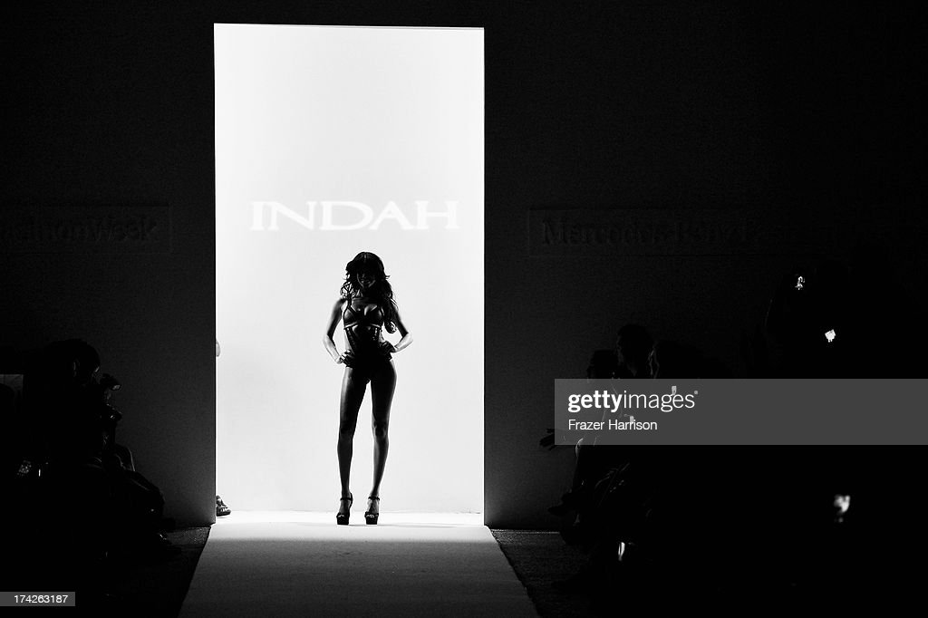 A model walks the runway at the Indah show during Mercedes-Benz Fashion Week Swim 2014 at the Raleigh on July 22, 2013 in Miami Beach, Florida.