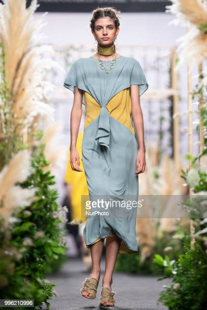 A model walks the runway at the 'Inunez' catwalk during the MercedesBenz Madrid Fashion Week Spring/Summer in Madrid Spain July 10 2018
