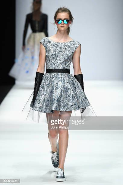 A model walks the runway at the Irene Luft show during the Berlin Fashion Week Spring/Summer 2019 at ewerk on July 3 2018 in Berlin Germany