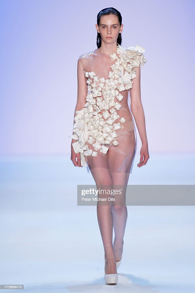 A model walks the runway at the Irene Luft Show during the Mercedes-Benz Fashion Week Spring/Summer 2014 at Brandenburg Gate on July 4, 2013 in Berlin, Germany.|