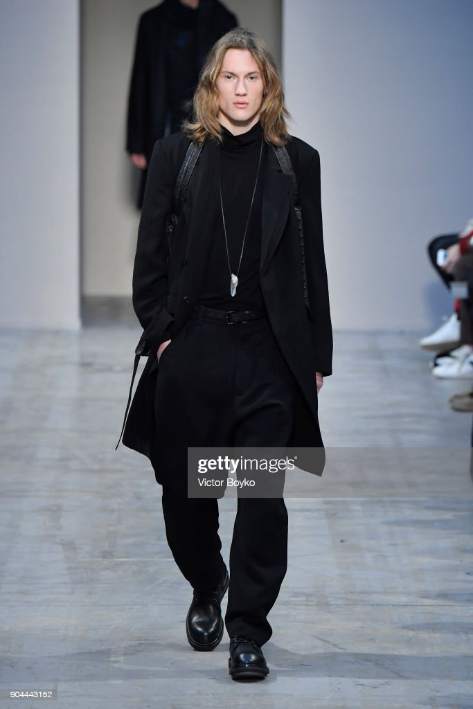 A model walks the runway at the Isabel Benenato show during Milan Men's Fashion Week Fall/Winter 2018/19 on January 13, 2018 in Milan, Italy.
