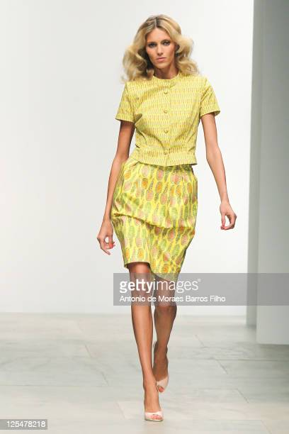 A model walks the runway at the Issa London S/S 2012 show at London Fashion Week at Natural History Museum on September 17 2011 in London England
