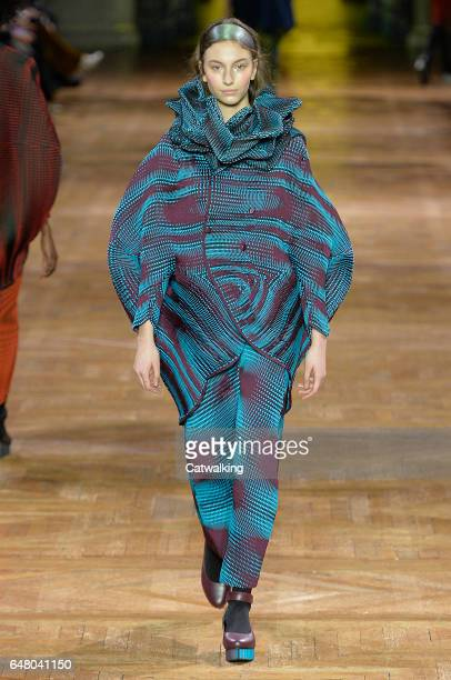 A model walks the runway at the Issey Miyake Autumn Winter 2017 fashion show during Paris Fashion Week on March 3 2017 in Paris France