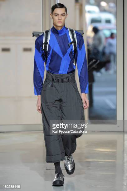 A model walks the runway at the Issey Miyake Men Autumn Winter 2013 fashion show during Paris Menswear Fashion Week on January 17 2013 in Paris France