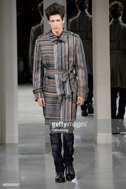 A model walks the runway at the Issey Miyake Men Autumn Winter 2014 fashion show during Paris Menswear Fashion Week on January 16 2014 in Paris France