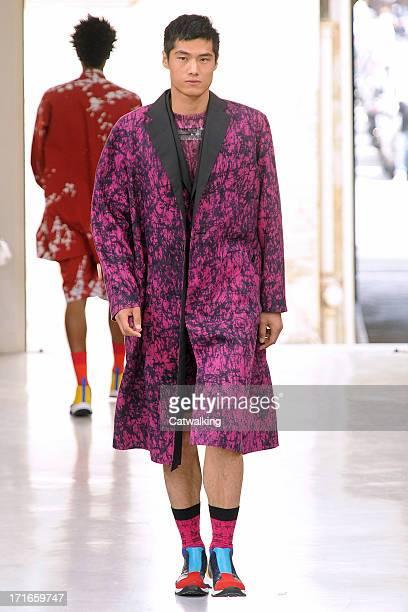 Model walks the runway at the Issey Miyake Men Spring Summer 2014 fashion show during Paris Menswear Fashion Week on June 27, 2013 in Paris, France.