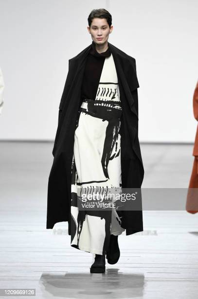 Model walks the runway at the Issey Miyake Ready to Wear fashion show during the Paris Fashion Week Womenswear Fall/Winter 2020-2021 on March 01,...