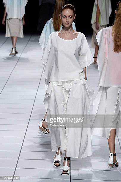 A model walks the runway at the Issey Miyake Spring Summer 2014 fashion show during Paris Fashion Week on September 27 2013 in Paris France