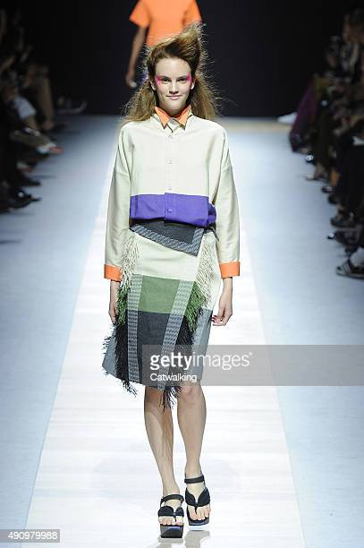 A model walks the runway at the Issey Miyake Spring Summer 2016 fashion show during Paris Fashion Week on October 2 2015 in Paris France