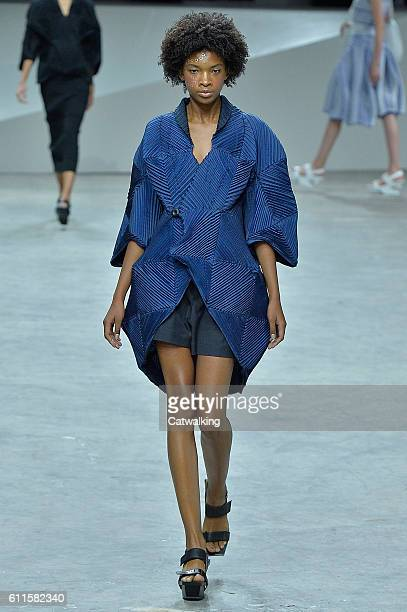 A model walks the runway at the Issey Miyake Spring Summer 2017 fashion show during Paris Fashion Week on September 30 2016 in Paris France
