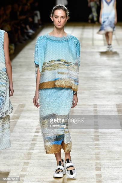 A model walks the runway at the Issey Miyake Spring Summer 2018 fashion show during Paris Fashion Week on September 29 2017 in Paris France