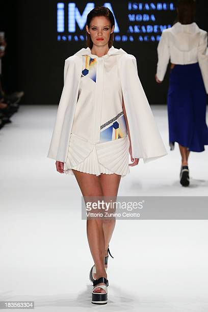 A model walks the runway at the Istanbul Moda Akademisi show during MercedesBenz Fashion Week Istanbul s/s 2014 presented by American Express on...