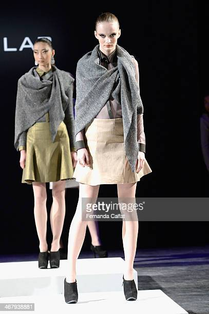 A model walks the runway at the Ivan Aguilar fashion show during MercedesBenz Fashion Week Fall 2014 at Lincoln Center on February 8 2014 in New York...