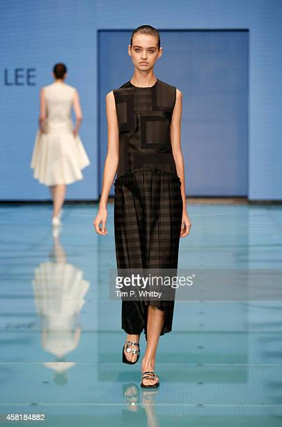 A model walks the runway at the J JS Lee show during Vogue Fashion Dubai Experience on October 30 2014 in Dubai United Arab Emirates