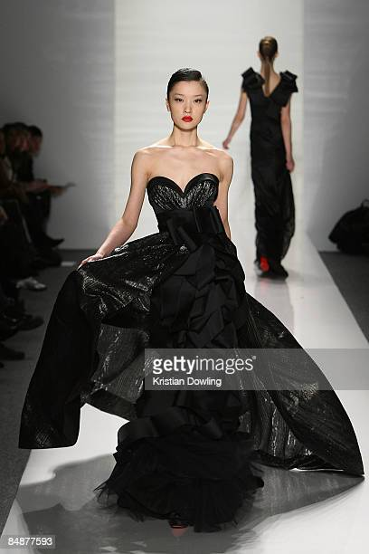 A model walks the runway at the J Mendel Fall 2009 fashion show during MercedesBenz Fashion Week in the Salon at Bryant Park on February 18 2009 in...