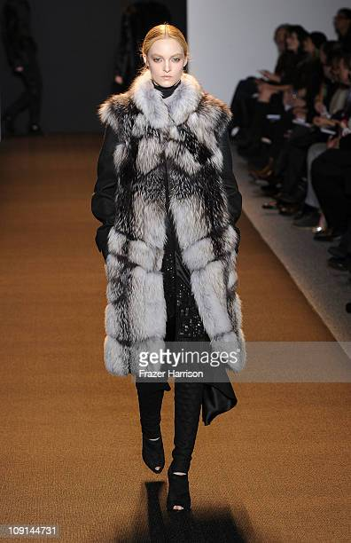 A model walks the runway at the J Mendel Fall 2011 fashion show during MercedesBenz Fashion Week at the NY State Armory on February 15 2011 in New...