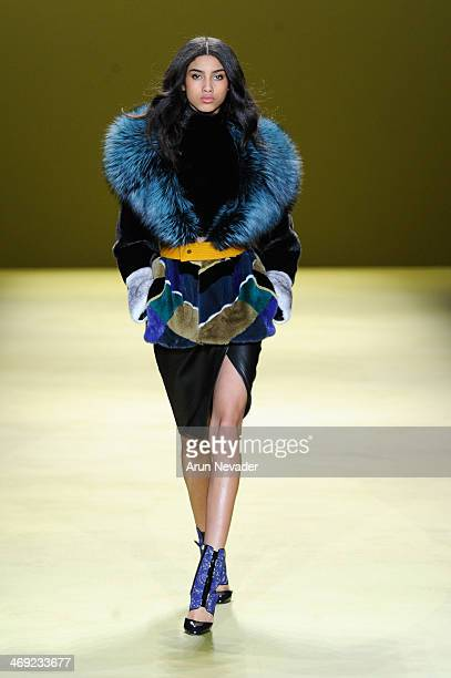 A model walks the runway at the J Mendel fashion show during MercedesBenz Fashion Week Fall 2014 on February 13 2014 in New York City