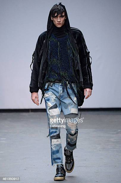 A model walks the runway at the James Long Autumn Winter 2015 fashion show during London Menswear Fashion Week on January 11 2015 in London United...