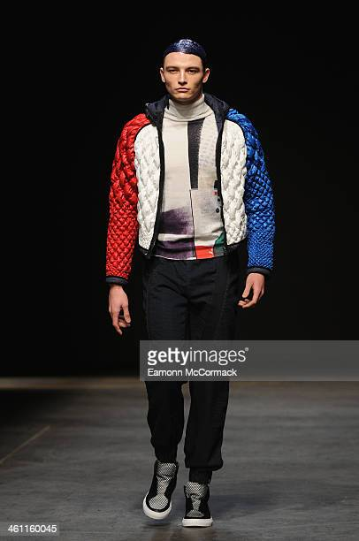 A model walks the runway at the James Long show during The London Collections Men Autumn/Winter 2014 on January 7 2014 in London England
