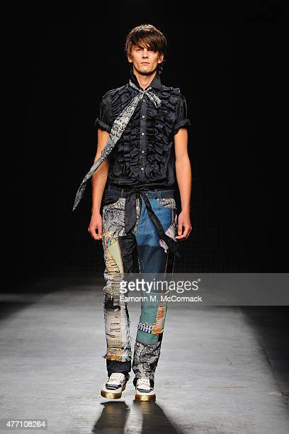 A model walks the runway at the James Long show during The London Collections Men SS16 at The Old Sorting Office on June 14 2015 in London England