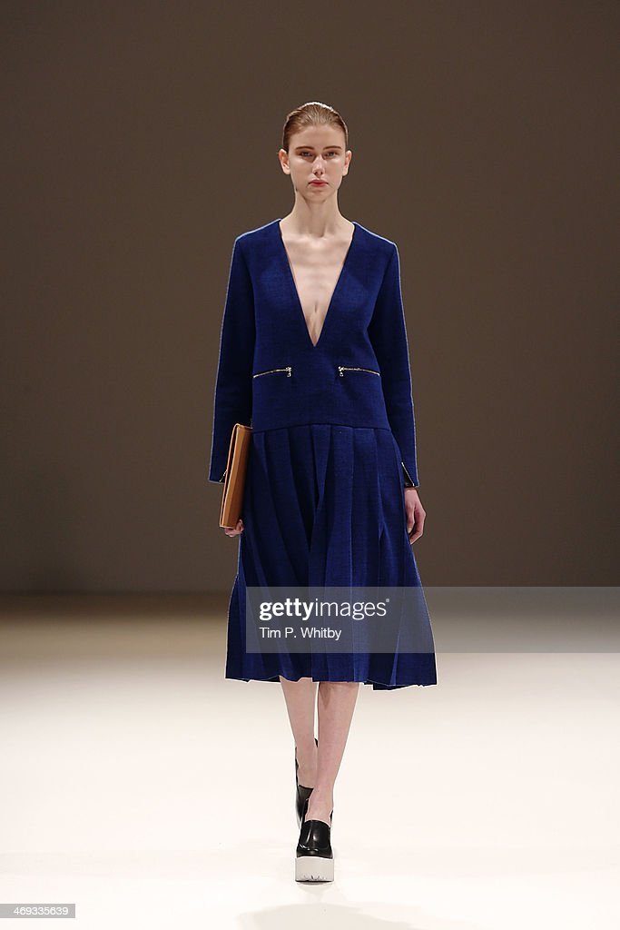 A model walks the runway at the Jamie Wei Huang show at the Fashion Scout venue during London Fashion Week AW14 at Freemasons Hall on February 14, 2014 in London, England.