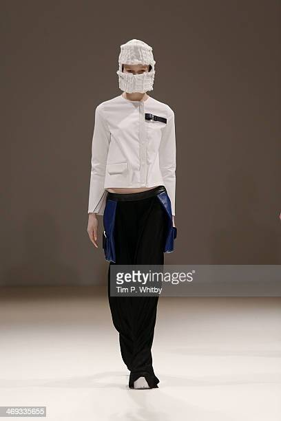 A model walks the runway at the Jamie Wei Huang show at the Fashion Scout venue during London Fashion Week AW14 at Freemasons Hall on February 14...